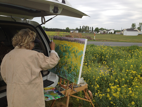 Priscilla painting outside