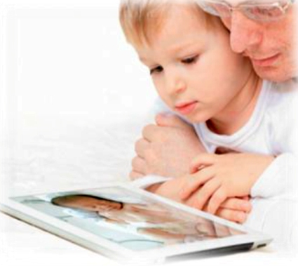 Father and son looking at NiCview photos on tablet computer