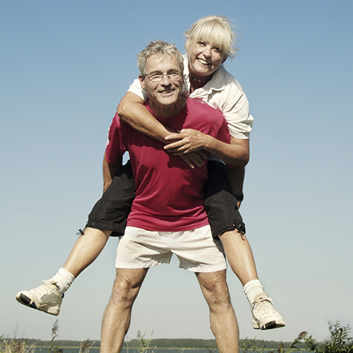 Older Couple Piggy Back 500pxSq